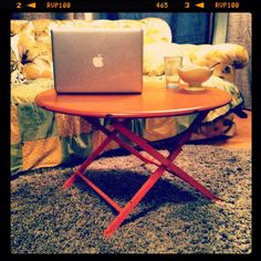 Orange metal coffee table from World Market, foldable and basically awesome!
