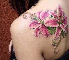 Lily Tattoos on Shoulder - I would do a dahlia or a couple of tulips.