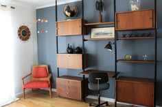 Very cool midcentury wall system with sliding doors and shelves to put a great vase or a favorite book.
