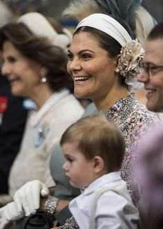 Glamorous Crown Princess Victoria of Sweden, couldn't hide her joy as she watched her little niece being christened today. Her youngest son, two-year-old Prince Oscar, sat obediently on his father's lap