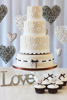 A cute cake all about love. Pretty lace hearts adorn this cream and chocolate brown vintage cake.