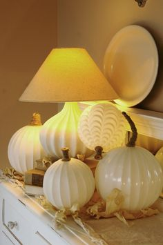 old light globes turned classic white pumpkins, I pinned this idea before, but this is a better view =)