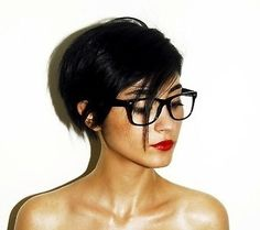 Great photo, I don't care hair, rocking glasses, and red lips.