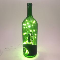 Battery Powered LED Nightmare Before Christmas Inspired Wine Bottle Light Recycled wine bottle made into a lamp with the Jack and Sally from Nightmare Before Christmas on the front. The lights inside are special battery powered LED lights so they will last much longer than ...