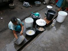 Washing up at a street-food stall in Yangon (Rangoon), Myanmar (Burma). #streetfood #washing #Yangon #Myanmar #Burma #Rangoon #SEAsia #Traveling #Travelling #Wandering #Wanderer #travel #travelblogger #travelphotography #wanderlust #NicksWanderings #everybodystreet #lensculture #streettog
