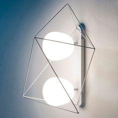 Applique Spiro, design E. Gallina AM.PM : prix, avis & notation, livraison.  Applique conçue par le designer Emmanuel Gallina, en exclusivité pour AM.PM. Parfaite sous tous les angles, sa structure filaire, en métal laqué mat, occupe l'espace avec légèreté. Peut être utilisée également en plafonnier.Composée d'un rail et de 2 globes en verre dépoli mat.L.52 x P.34 x H.31 cm.Douilles E14 pour ampoules fluocompactes 11 W non fo...
