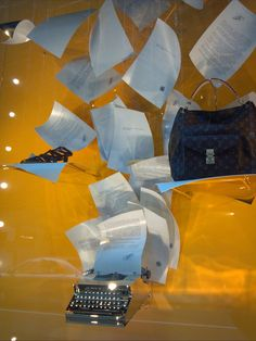 Louis Vuitton NYC store window display 2013, with flying chrome typewriter. Photo by Joanie Ballard
