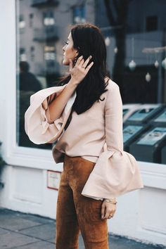 Try a blush blouse with bell sleeves. Pair this top with suede pants this winter. Let DailyDressMe help you find the perfect outfit for whatever the weather!