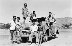 Members of the Olympic Youth Club at a picnic on Paremata Beach. Their Chevrolet van had been damaged on the way to the picnic when a tyre burst a. Chevrolet Van, Youth Club, Youth Culture, New Zealand, Olympics, Picnic, America, Beach, 1950s