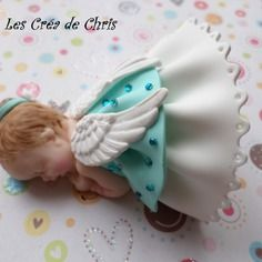 Jolie petite fille thème ange en fimo.