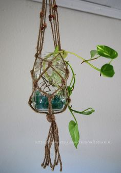 A bunch of these hung together would look great on my deck filled with tealights on a summer night...  Hand Made Natural Wire macrame Mason Glass Jar by miloblukiki, $18.00