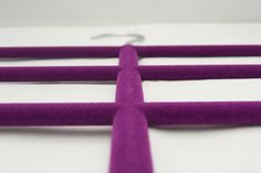 A close up photo of our velvet covered luxurious hangers! For your chance to win a double pack of Hanger Management's Scarf Hangers (RRP £14.99 each) simply go to www.hanger-management.co.uk then go to the contact page leave your name, email address and country of residence then send! That's it, nothing more! Good luck!