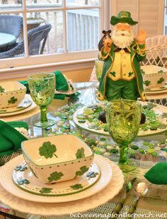 Set a St. Patrick's Day tablescape table setting with with Clover & Shamrock dishes and a leprechaun centerpiece. St Patrick's Day Decorations, Decoration Table, St Pattys, St Patricks Day, Saint Patricks, Chandeliers, Happy St Paddys Day, St Patrick's Day Crafts, Luck Of The Irish