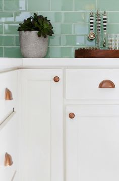 Glass Subway Tile from Modwalls + Copper Hardware and White Cabinets