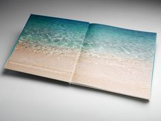 Intelligent design and masterful photography help to create a compelling story for 57 Ocean, Miami Beach properties. Part of what makes this piece unique is the printed fabric cover wrap gradient with 3 PMS colors and foil stamping. This square-format, 122-page cased book was designed by DBox.The amount of time the DBox team spent in advance collaboration and clear direction helped to make this finished work both beautiful and effective for the end client. Pms Colour, Beach Properties, Intelligent Design, Foil Stamping, Fabric Covered, Miami Beach, Collaboration, Printing On Fabric, Real Estate