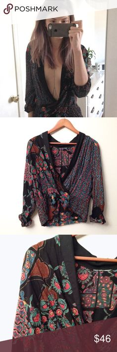 Plung neck Blouse Stunning printed deep v blouse, size M. Funky print. Tighter at the waist. Perfect condition ✨ Free People Tops Blouses