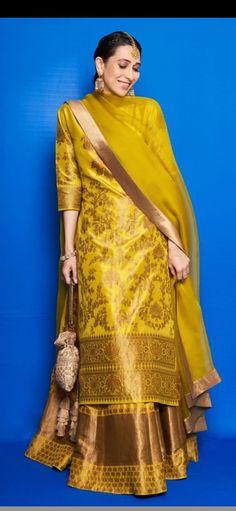 Karisma Kapoor chose a yellow lehenga set for Armaan Jain's mehandi - Indian Ethnic Wear Designer Party Wear Dresses, Kurti Designs Party Wear, Indian Attire, Indian Ethnic Wear, Indian Look, Ethnic Dress, Ethnic Outfits, Indian Outfits, Serie Suits