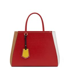 2JOURS Brick red elite calfskin handbag with contrasting sides. Enamel bar with Fendi logo and gold edging and metalware. Charm, double handle and adjustable, detachable shoulder strap. Magnetic closure. Two internal compartments divided by a xipped partition. Made in Italy