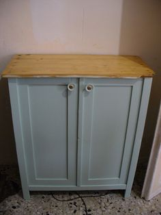 In the kitchen: new, pretty old, saved, cabinet. I 've used homemade chalk paint and opaque polish.