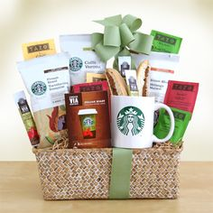 """""""Starbucks Get up and Go Box""""  This gift will be a hit for the Starbucks coffee lover on the go. The hot/cold travel mug is sure to become a daily favorite and it comes with four types of Starbucks coffee including Pikes Place Roast, Cafe Estima, Blond roast and Sumatra Blend. For Starbucks anytime, they will also enjoy the VIA ready brew in Italian Dark roast flavor and spiced chocolate and cherry walnut biscotti."""