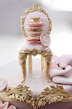 The cake topper featured an upright chair stacked with pink and gold dishes, ready for a tea party.  Lovely!