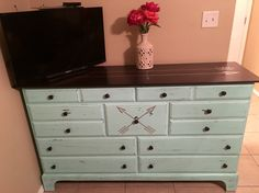 Mint color dresser with arrows.