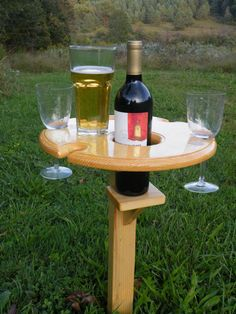 Outdoor Wine Glass Holder  We now have a folding version here: https://www.etsy.com/listing/387146152  Take your wine outside with you when camping or relaxing around the fire with this unique wine stand. It solves the problem of where to set your wine glass without spilling it. This one piece stand has a sturdy 3/4 dowel at the bottom which is pushed into the soil to hold the stand upright. The entire stand is made of solid pine, with no assembly required, and no moving parts. Stand is…