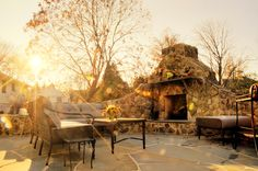 Photo about Low-angle view of a flagstone patio with an outdoor stone fireplace and furniture. Image of affluence, yard, outdoor - 12893155 Outdoor Stone Fireplaces, Natural Stone Fireplaces, Stone Fireplace Designs, Fireplace Ideas, Fire Pit Chairs, Flagstone Patio, Built In Seating, Outdoor Furniture Sets, Outdoor Decor