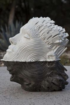 Escultura-unraveling-steel-ribbons-gil-bruvel