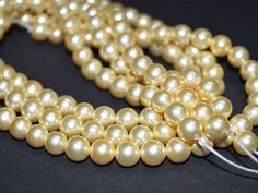 8 mm Luster Golden Seashell, Pearl beads, Imitation pearls, Round Shell Pearl, Golden pearls, Shell pearls, Faux pearls, Smooth pearls, Pearl bead.  Please note that these are not freshwater or...