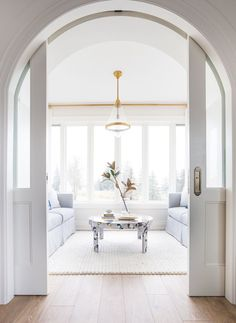 Modern Farmhouse Ideas: Custom Arched Pocked Doors That Lead into the Sunroom - Butter Rd Home Tour   Coco & Jack