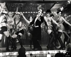 "Master of Ceremonies (Joel Grey): ""In here, life is beautiful. The girls are beautiful. Even the orchestra is beautiful!"" -- from Cabaret (1972) directed by Bob Fosse"