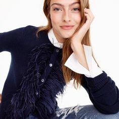 Crewneck cardigan sweater with feather trim