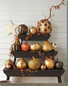 Fall is here! We think pumpkins and gourds are a fun and easy way to add fall inspiration to your décor. Metallic is the trend this season. Get a can of metallic spray paint and go to town. You can use them in a display like this on your front porch, put a few on your fireplace mantle or dining