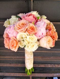Mix of Romantic Antique Garden Roses, Juliet Garden Roses and peach and white spray ross... lace wrapped for vintage chic feel:-)