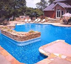 Inground pools on sloped yard 5 ways to build pool pinterest sloped backyard pools and for Swimming pool maintenance costs