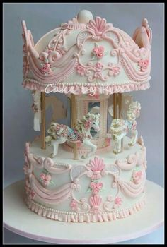 Captivating carousel in pink and white. Very detailed horses and decorative piping on the carousel itself. Beautiful for a wedding or a girl's birthday party.