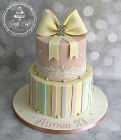 Vintage Pastel Crystal Bow 2 Tier Birthday Cake With Cake Lace And Pearls. - http://pontycarlocakes.com/vintage-pastel-crystal-bow-2-tier-birthday-cake-with-cake-lace-and-pearls/ #2Tier, #Birthdaycake, #Bling, #Blushpink, #Bow, #Cake, #Cakelace, #Crystals, #Ganache, #Pastel, #Pontycarlocakes, #Sharpedge, #Spots, #Striped, #Vintage