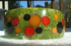 Injected polka dot Bakelite bangle.