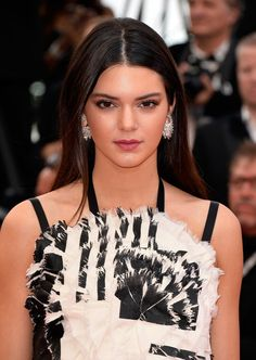 At the Cannes Film Festival Opening Ceremony, Kendall Jenner wore a berry lip and sleek center-parted hair.