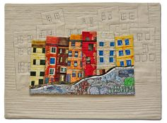 """morin - looks as though the colored houses are portrait- mounted on quilted piece with """" ghost"""" houses"""