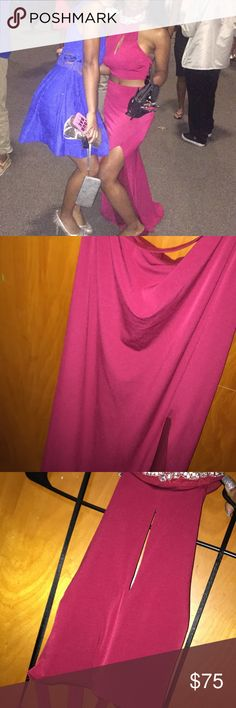 Windsor prom dress , worn once, perfect condition Burgundy dress, Bedazzled around neck, two-piece, open back, slit up the leg, crosses in the back, very comfortable and strechy Windsor Dresses Prom
