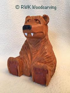 Sitting Bear carved by RWK Woodcarving