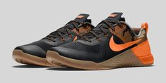 The Nike Metcon 1 Black/Total Orange release date is officially set. The latest colorway of the all-encompassing trainer mixes black, camo, orange. . .