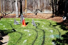 We spray painted our own race track in the backyard, and raced in our cardboard box cars!