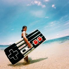 Shaped liked the retro 80's game controller, this pool float is sure to be a big hit. A must for any gamer, this unique inflatable raft is great for the pool, lake, or beach. Made of heavy vinyl, this retro game controller pool float inflates to over 5 fe