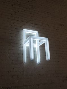The 'Holey chair' by japanese designer Takeshi Miyakawa is a light fixture constructed from white acrylic in the shape of a chair frame. LEDs embedded within illuminate the form. it can be placed on the floor or installed on the wall.