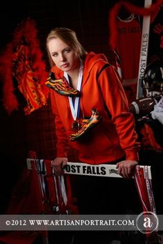 Track star, high school senior and a great athlete.  Wednesday shows her school spirit and love of hurdling in one of her awesome senior pictures!
