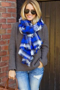Beautiful plaited white and blue muffler with sweater and denim jeans