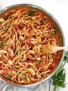 Spicy Seafood Pasta with Tomato Butter Sauce is a simple go-to weeknight dinner that can be made with pantry staples. BudgetBytes.com